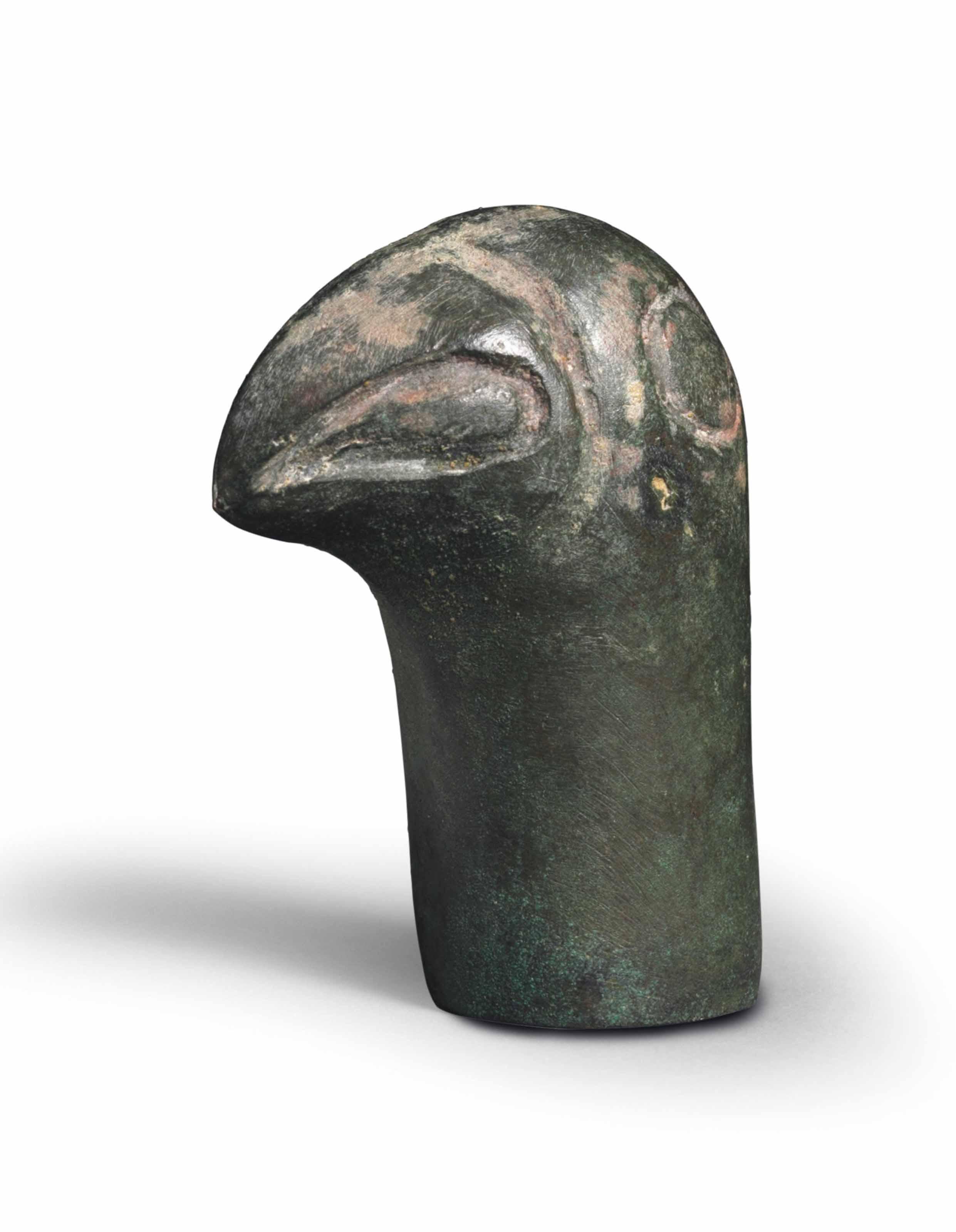 A BRONZE BIRD-HEADED FINIAL