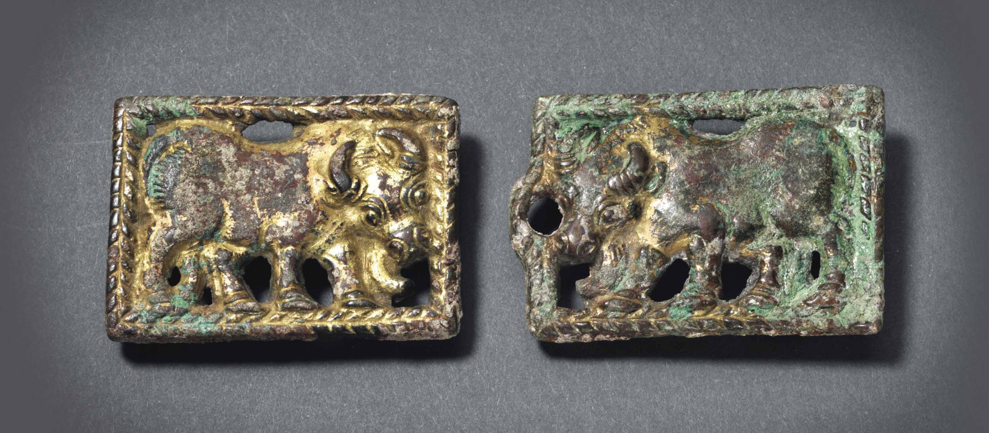TWO GILT-BRONZE BELT BUCKLES W