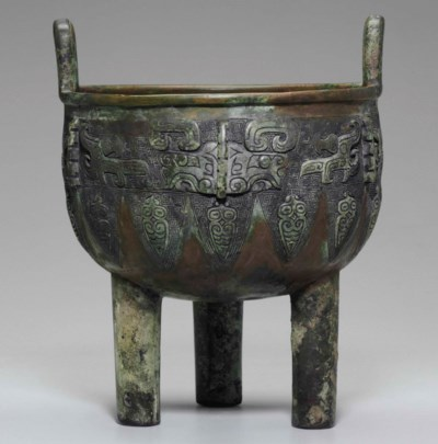 A BRONZE RITUAL TRIPOD FOOD VE