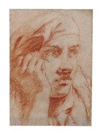 Head of a young man, his right hand against his cheek