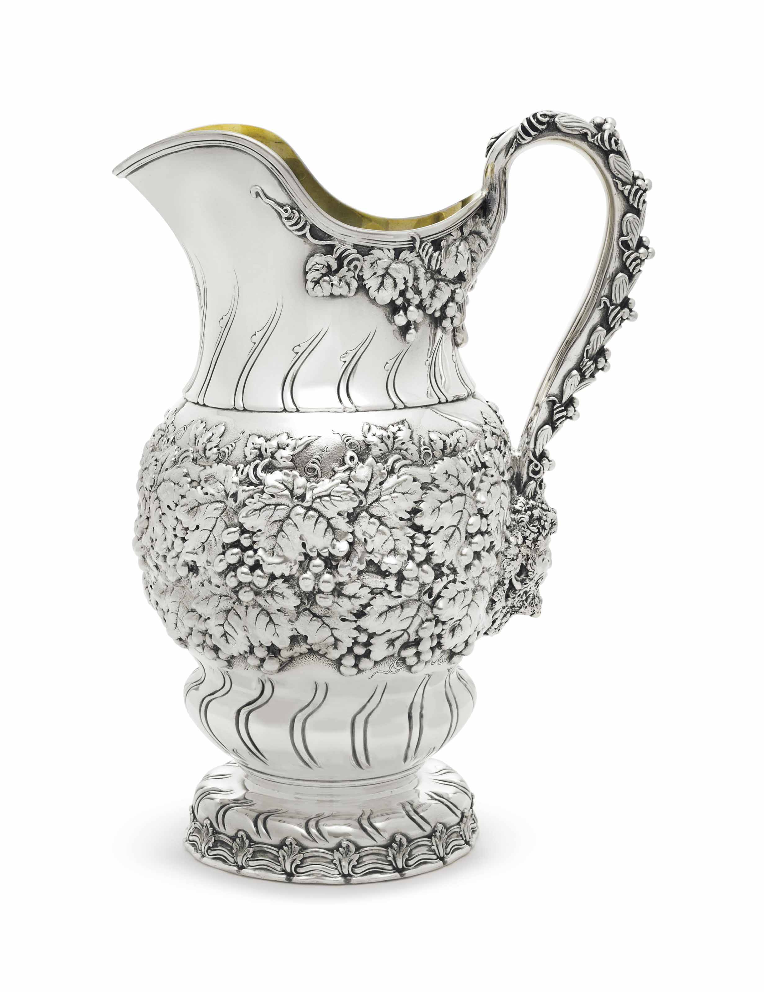 A LARGE SILVER WATER PITCHER
