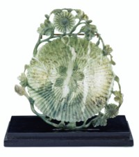 A CHINESE CARVED MOTTLED PALE GREEN JADE MUGHAL-STYLE LOTUS FLOWER DISH
