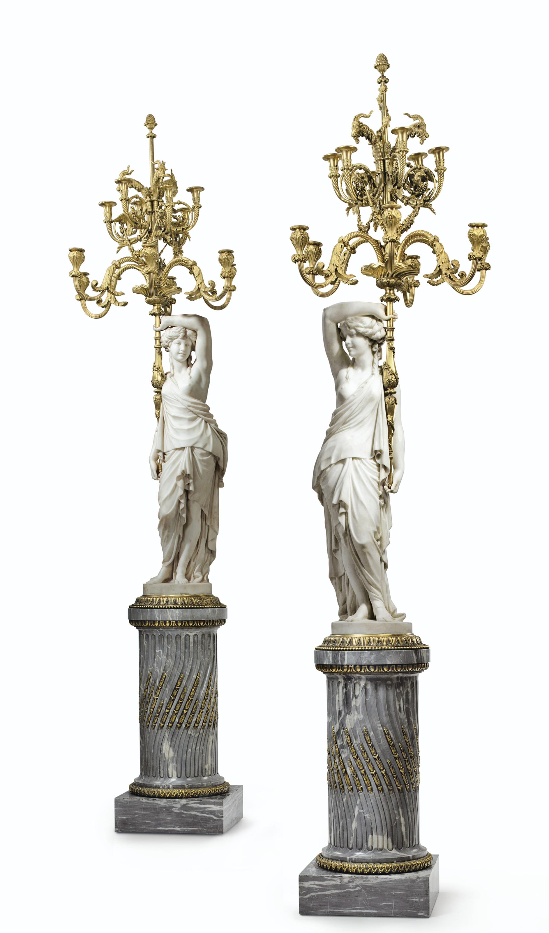 A PAIR OF LARGE FRENCH ORMOLU-MOUNTED BLEU TURQUIN AND CARRARA MARBLE TWELVE-LIGHT TORCHERES