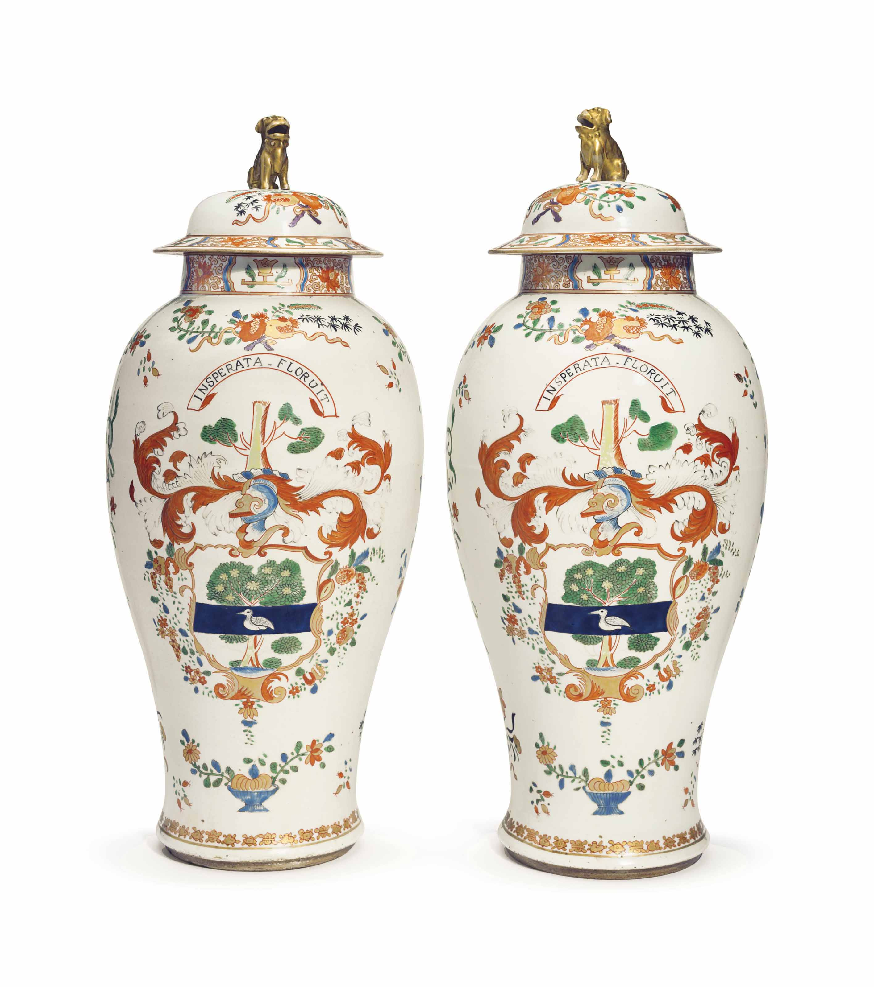 A PAIR OF CHINESE EXPORT-STYLE LARGE ARMORIAL VASES AND COVERS