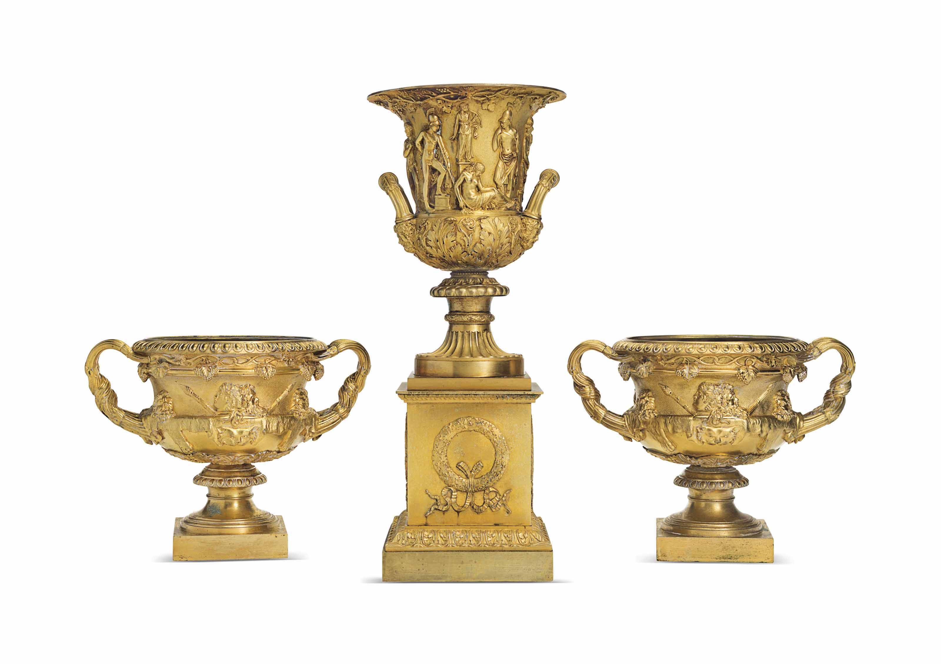 A PAIR OF ORMOLU WARWICK VASES AND AN ORMOLU MODEL OF THE ME...