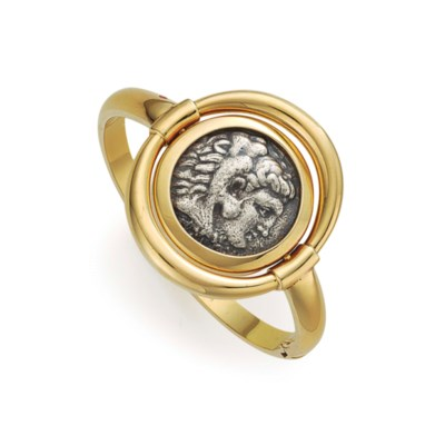 A COIN AND GOLD BANGLE BRACELE