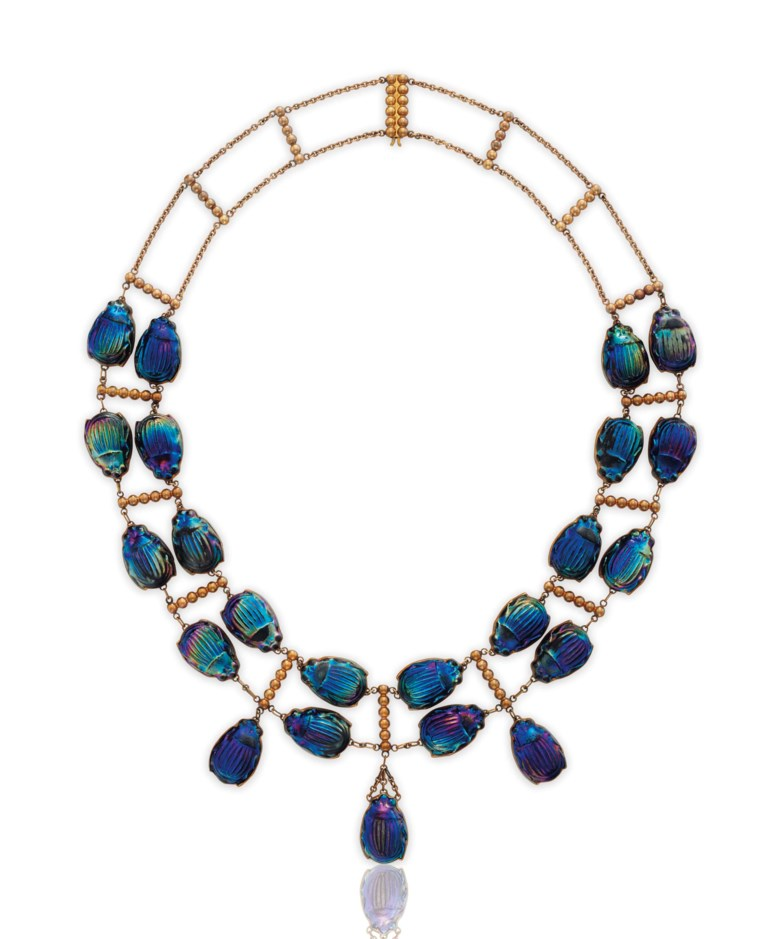 An iconic favrile glass beetle and gold necklace, by Louis Comfort Tiffany, Tiffany & Co. Sold for $106,250 on 20 June 2017 at Christie's in New York