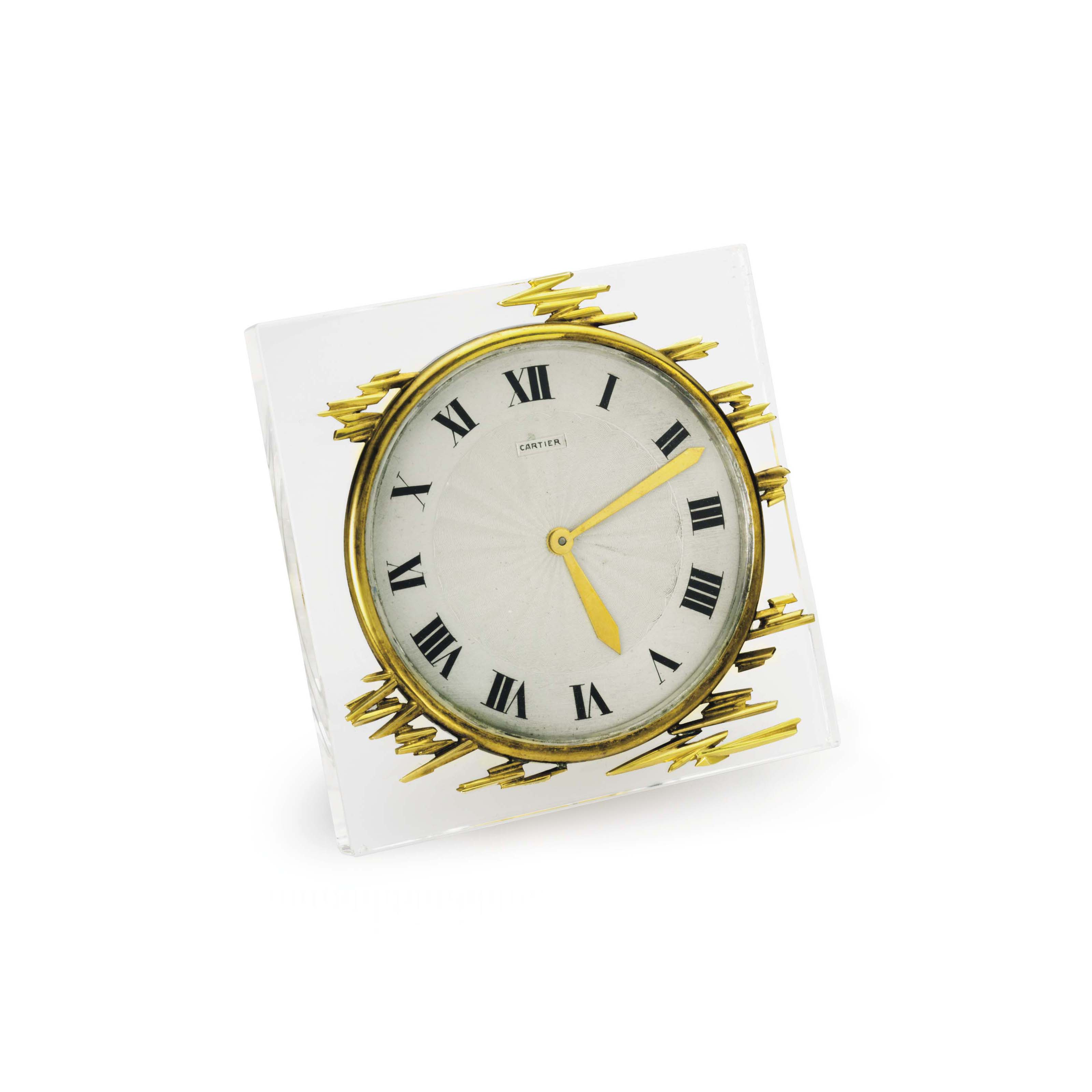 A ROCK CRYSTAL AND GOLD DESK CLOCK, BY CARTIER