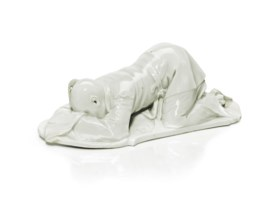 A NYMPHENBURG PORCELAIN WHITE-GLAZED KNEELING FIGURE