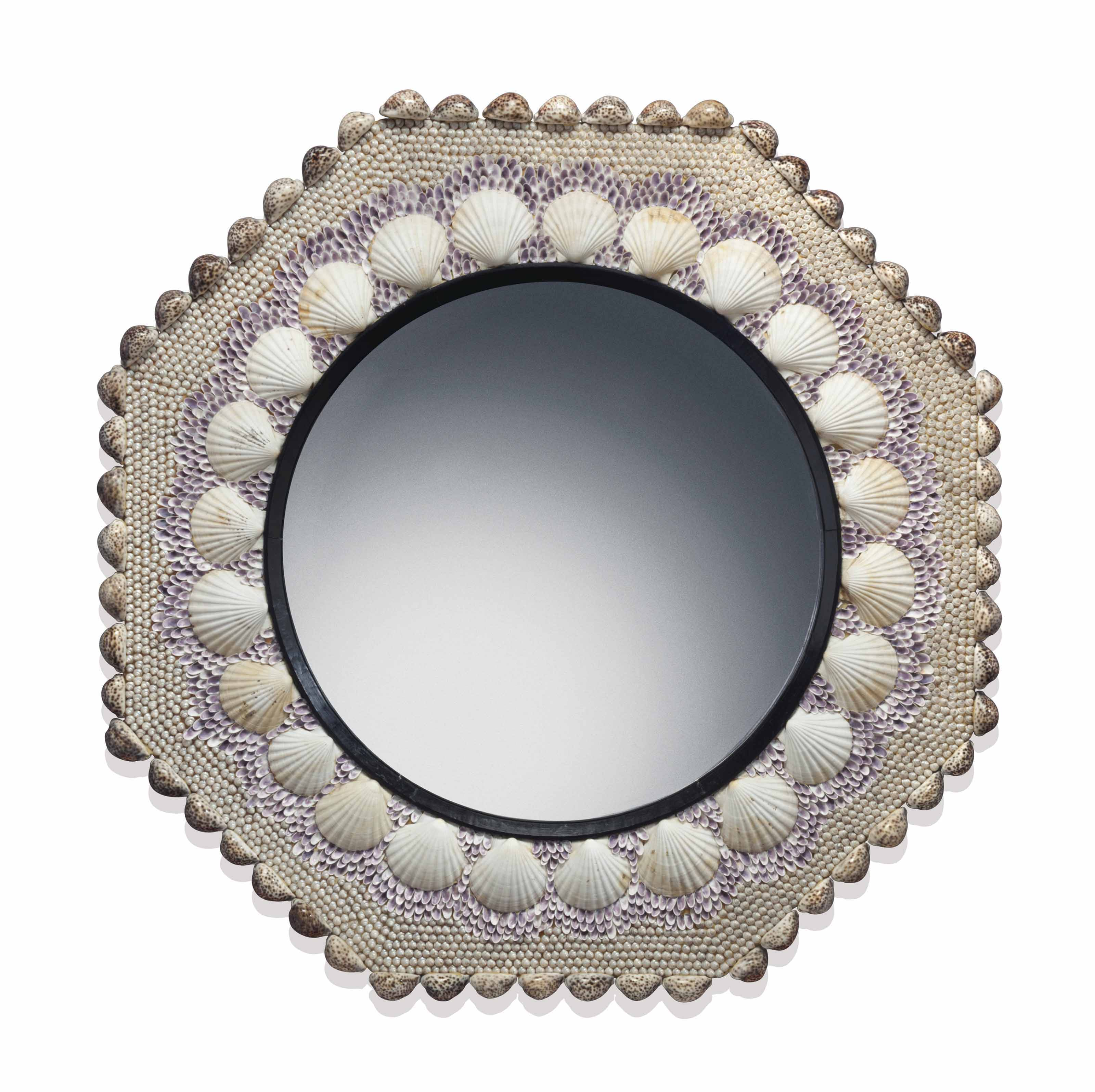 A SHELL ENCRUSTED OCTAGONAL CONVEX MIRROR