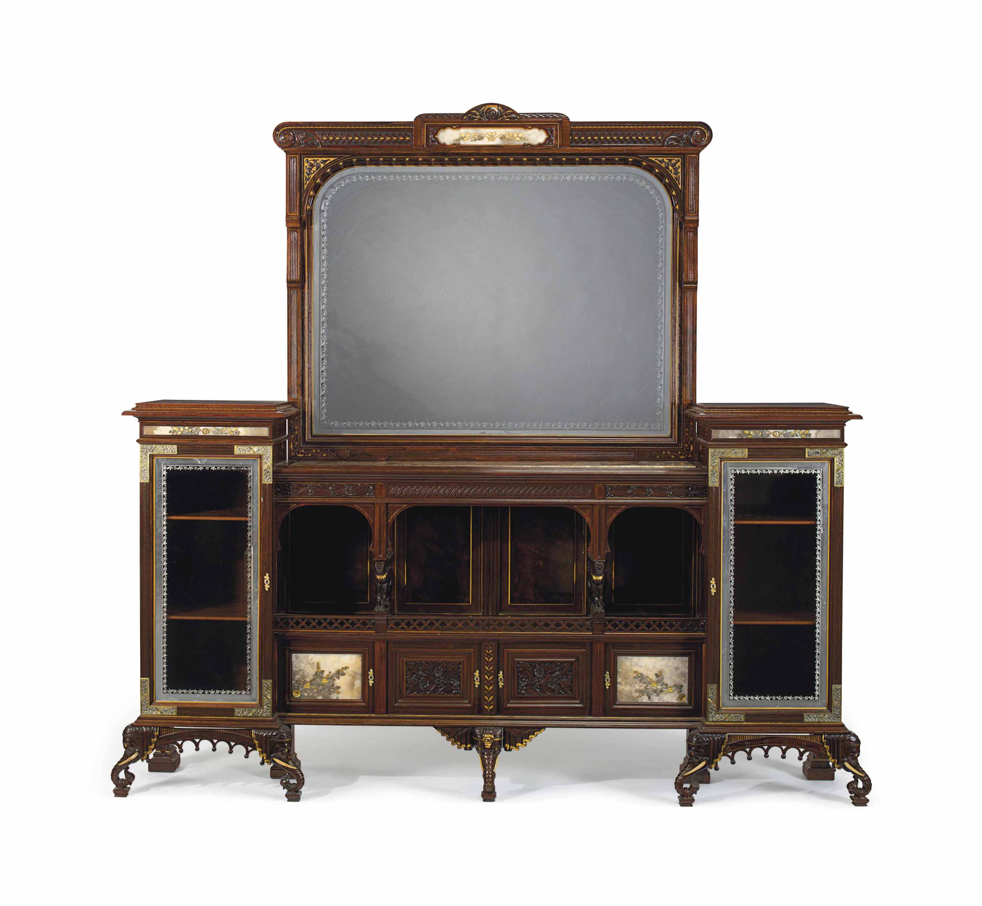 AN AESTHETIC MOVEMENT PARCEL-GILT, PART-EBONIZED, SILVER, ORMOLU AND ONYX- MOUNTED ROSEWOOD SIDEBOARD AND OVER-MIRROR