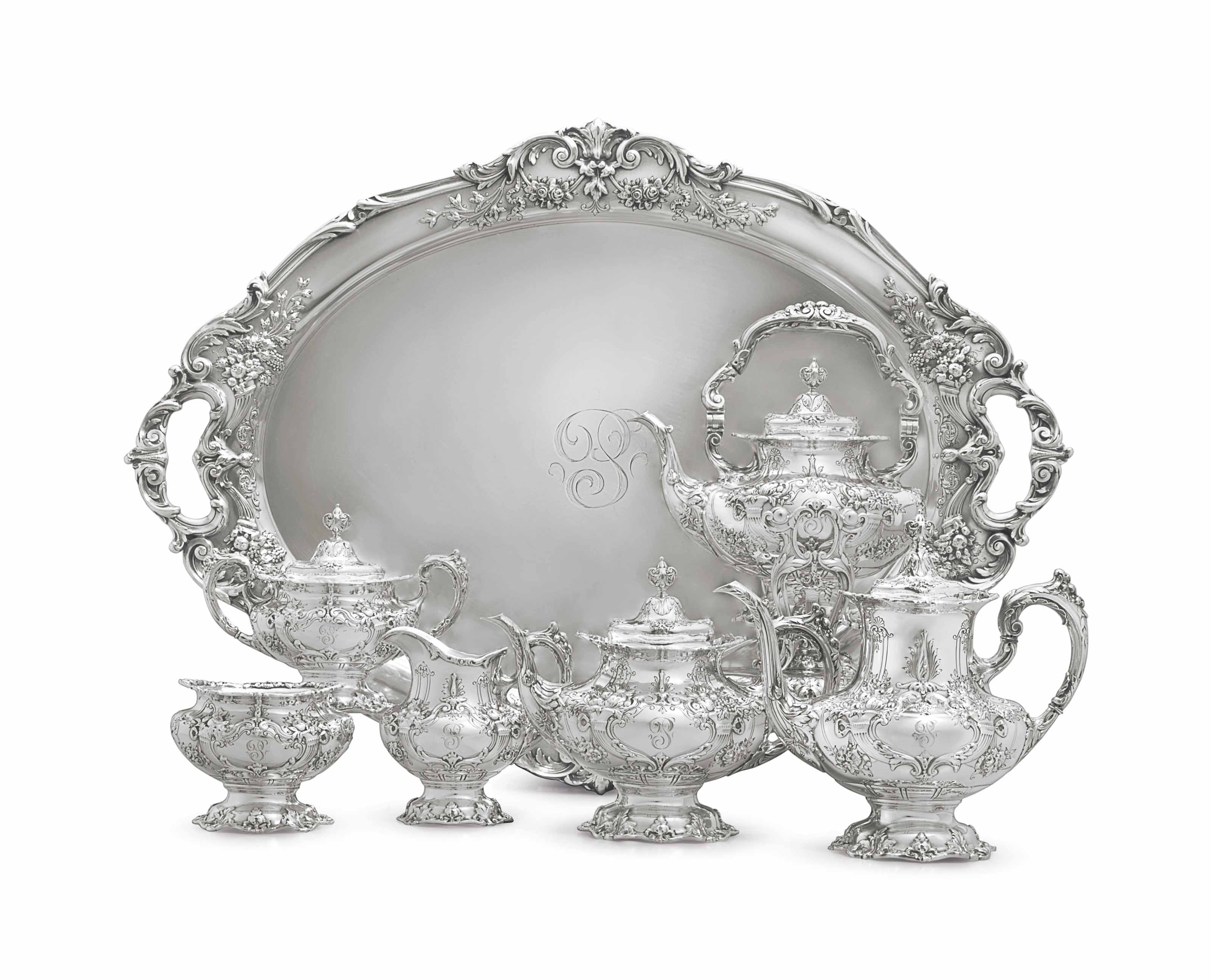 A SILVER SIX-PIECE TEA AND COFFEE SERVICE WITH MATCHING TRAY