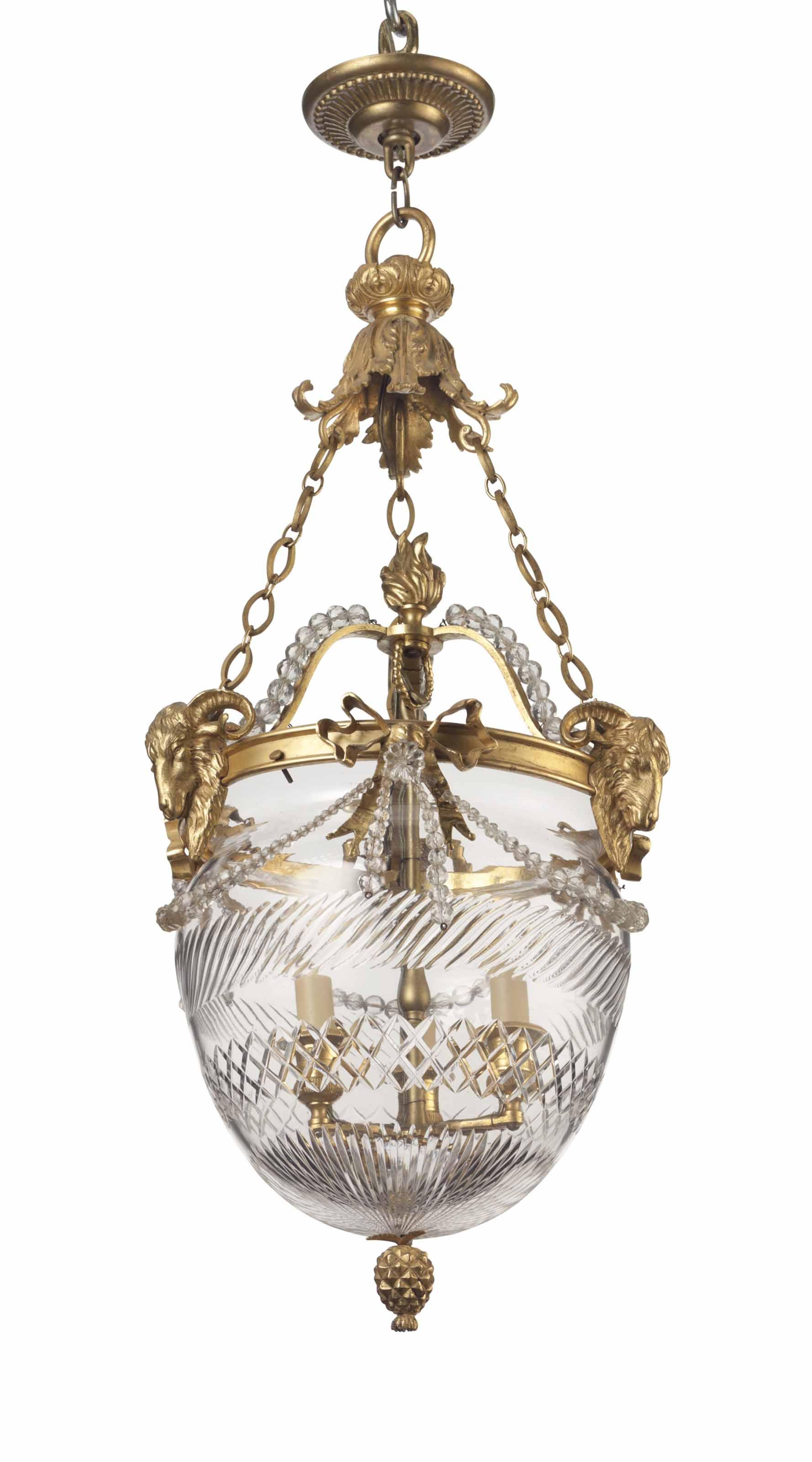 A FRENCH ORMOLU AND CUT-GLASS HALL LANTERN