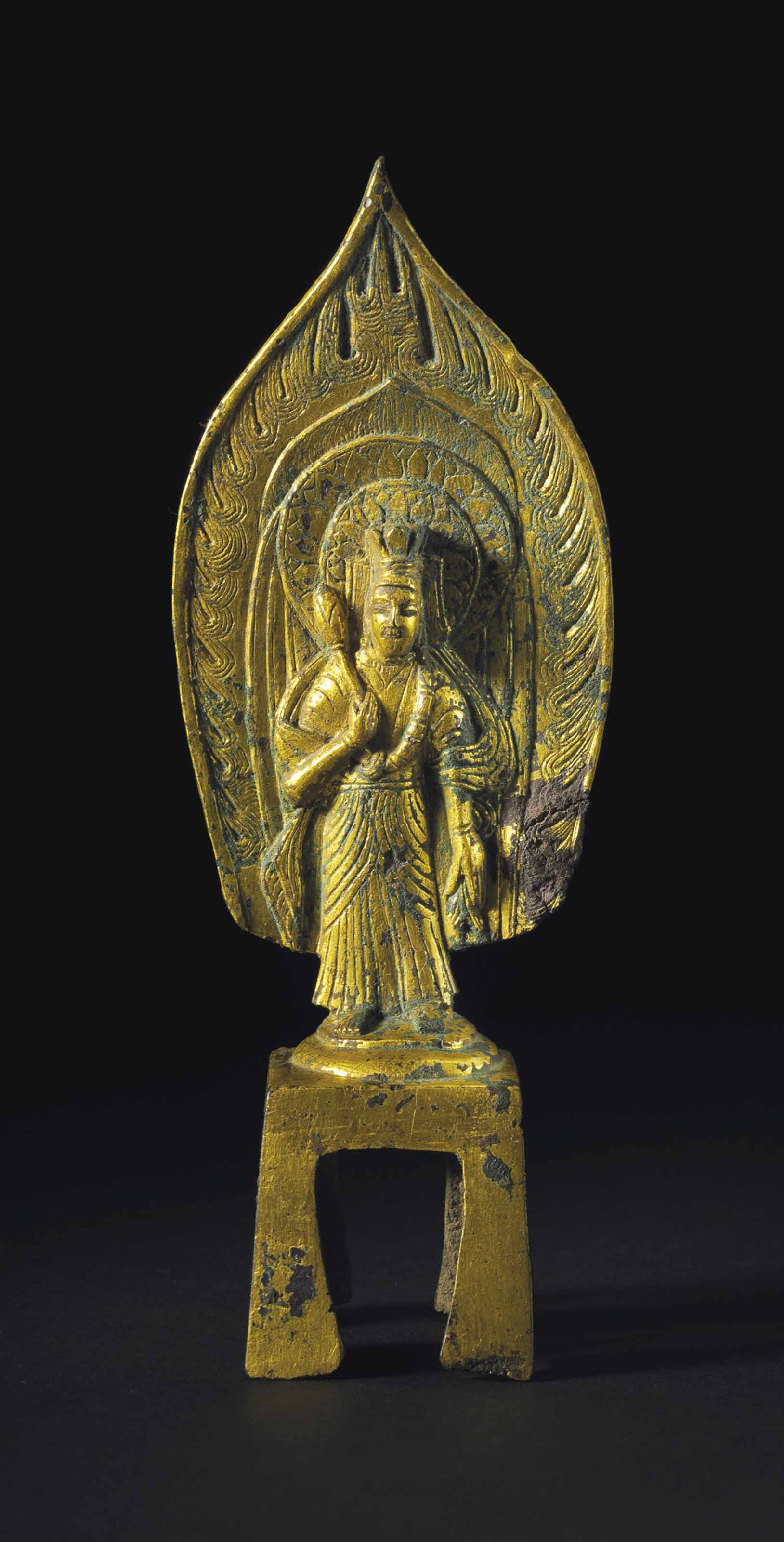 A DATED GILT-BRONZE FIGURE OF