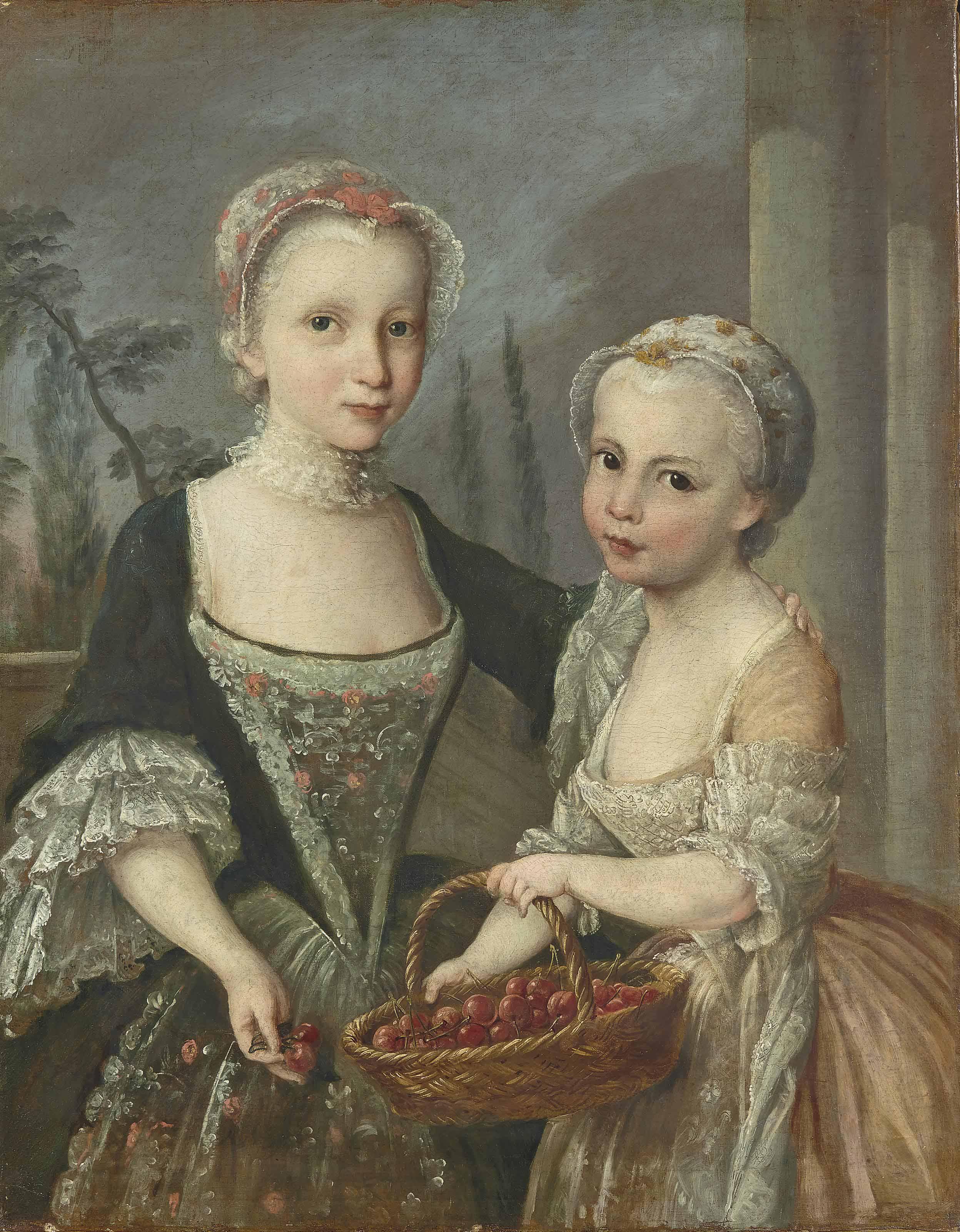 Deux petites filles tenant un panier de cerises