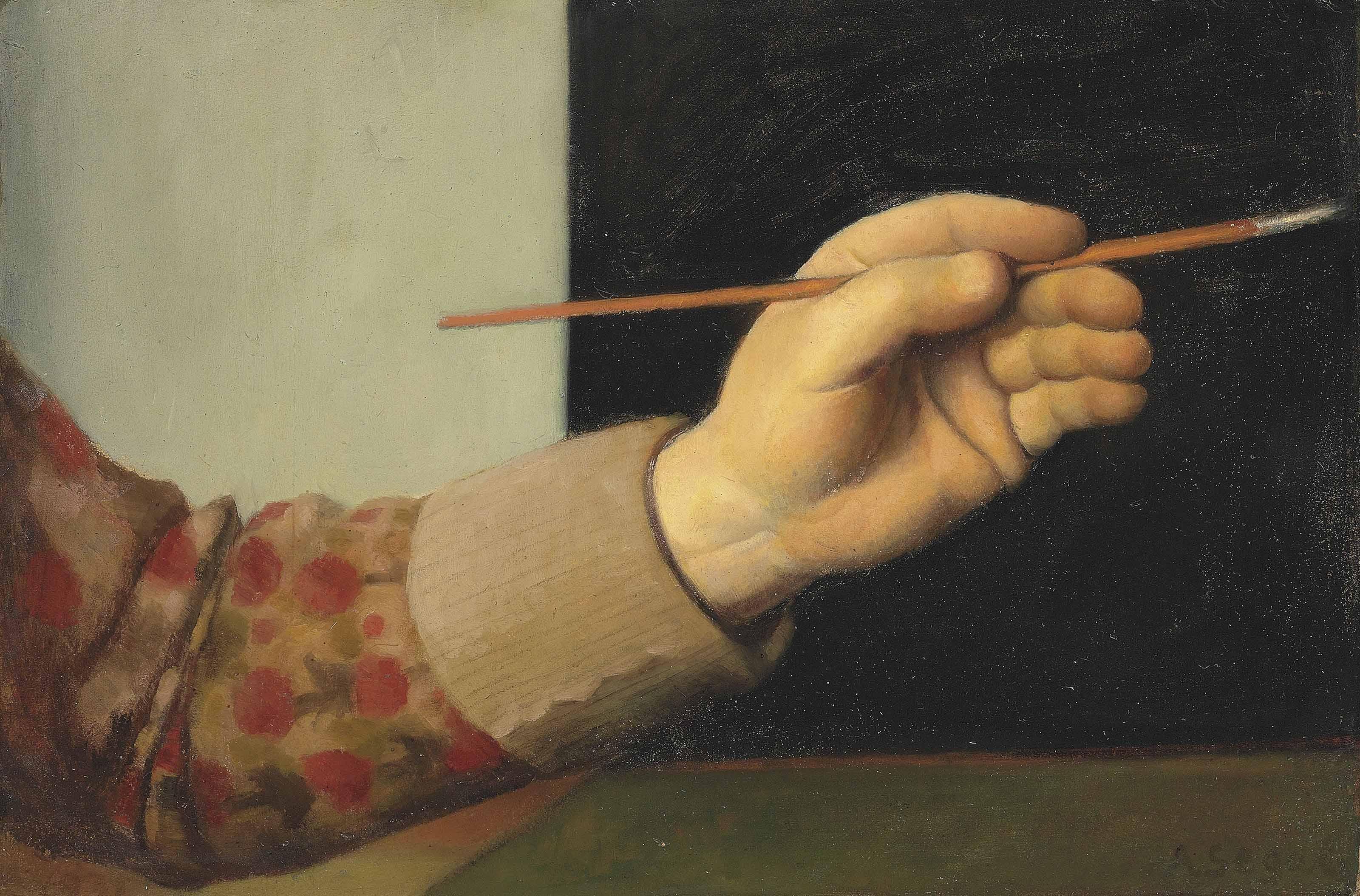 Hand des Künstlers mit Pinsel