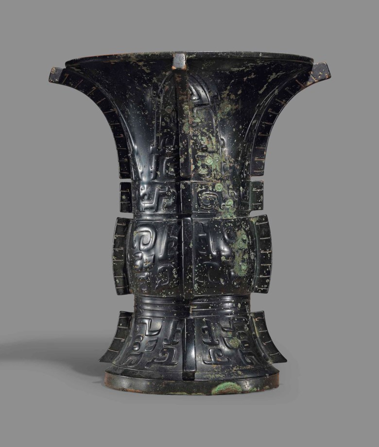A magnificent and important bronze ritual wine vessel, Zun, Late Shang-early Western Zhou dynasty (12th-10th century BC). 12¼  in (31.2  cm) high. Sold for £272,750 on 15 May 2018 at Christie's in London