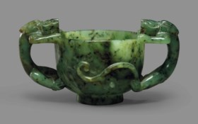 A SPINACH-GREEN JADE TWO-HANDLED 'CHILONG' CUP