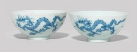 A SMALL PAIR OF BLUE AND WHITE 'DRAGON' CUPS
