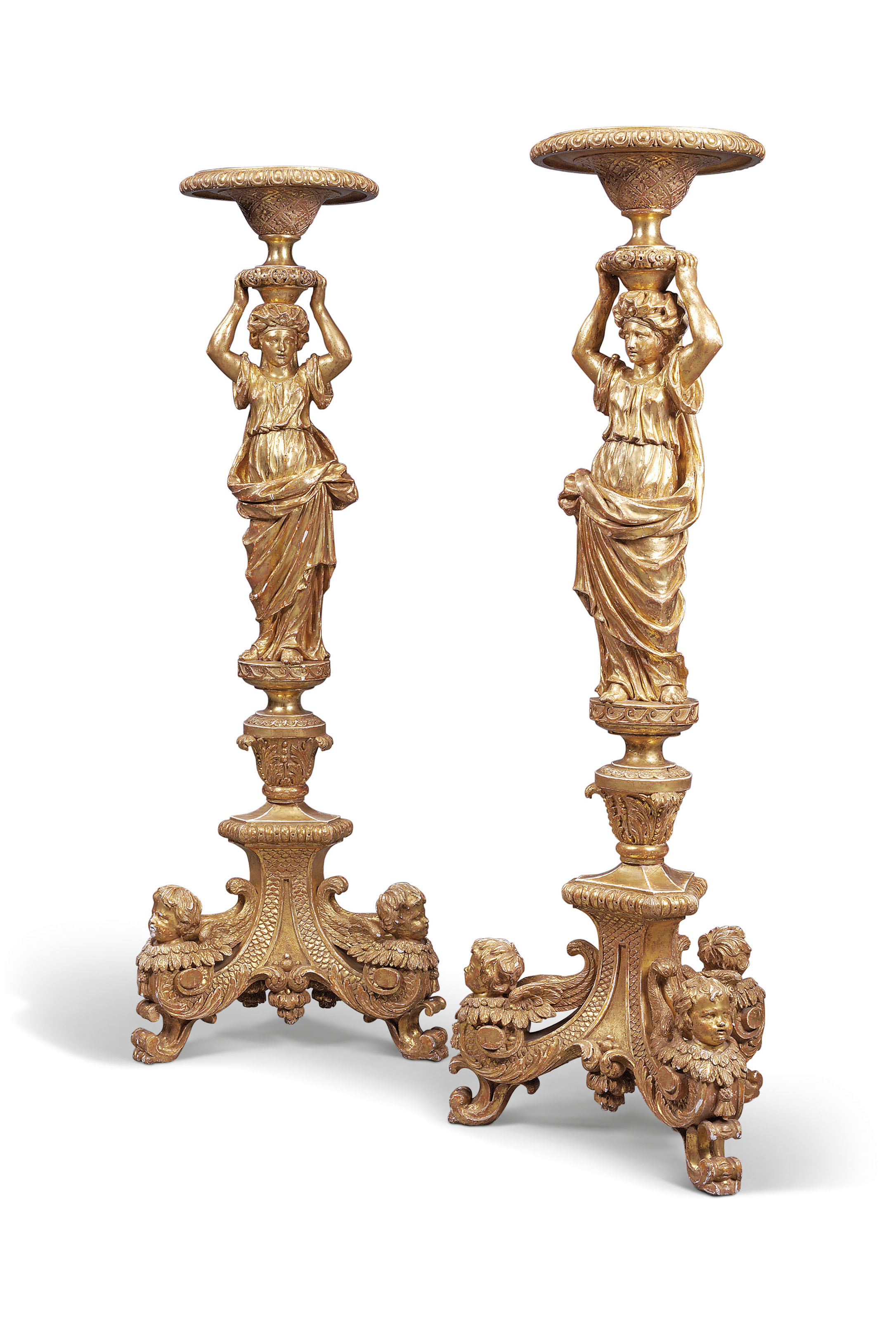 A PAIR OF GEORGE II GILTWOOD TORCHERES