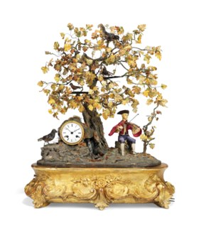 A FRENCH GILTWOOD AND COMPOSITION MUSICAL FIGURAL AND SINGIN