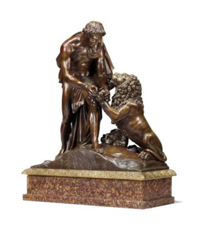 A FRENCH PATINATED-BRONZE GROUP OF ANDROCLES AND THE LION