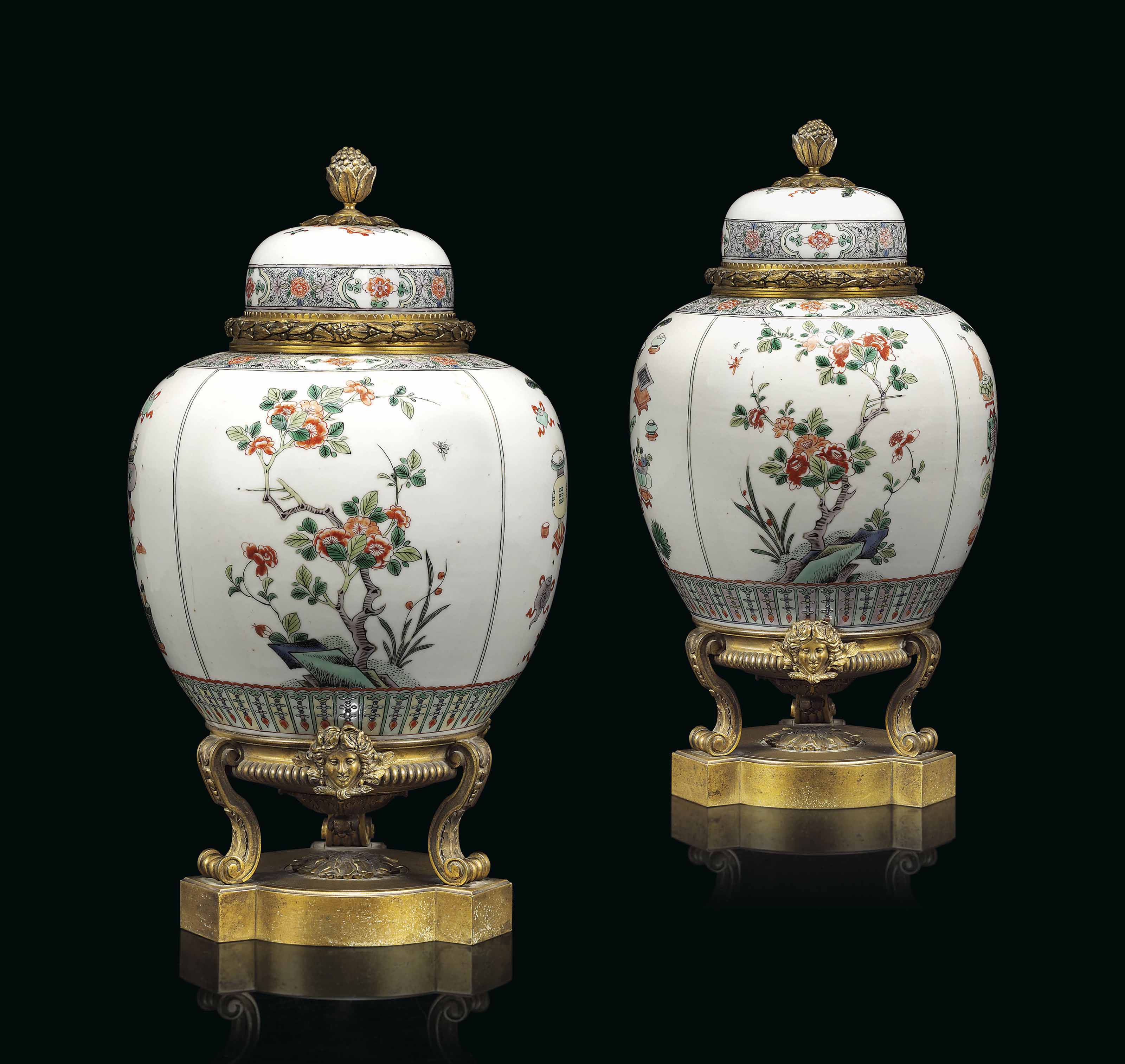 A PAIR OF FRENCH ORMOLU-MOUNTED PORCELAIN VASES AND COVERS