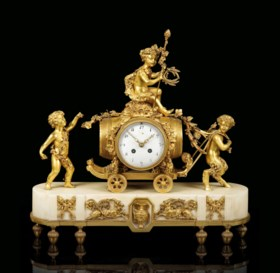 A FRENCH ORMOLU AND WHITE MARBLE STRIKING MANTEL CLOCK