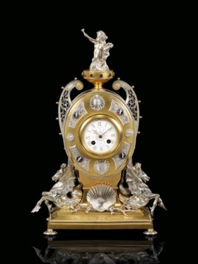A VICTORIAN GEM-MOUNTED GILT AND SILVERED-BRONZE STRIKING MA