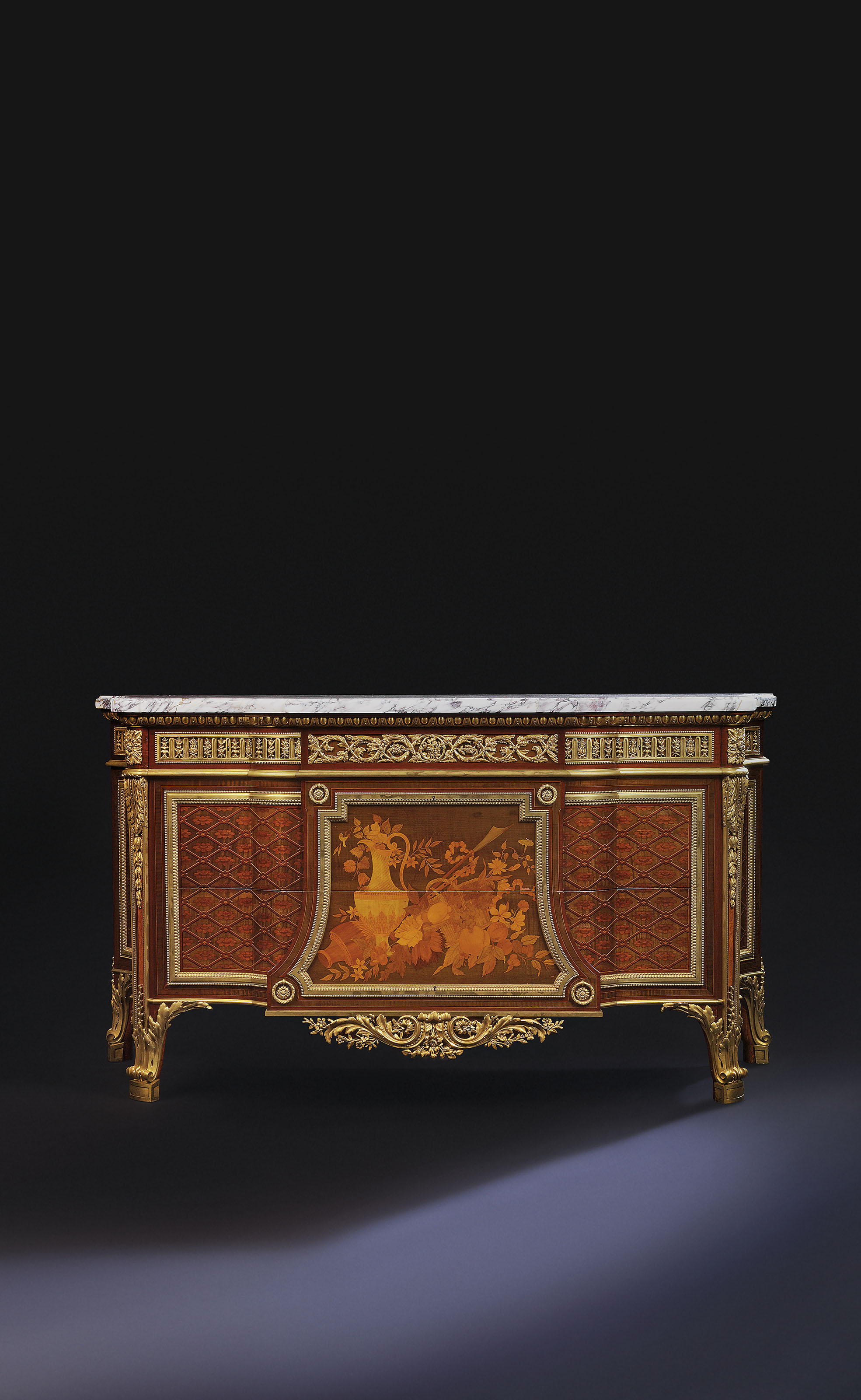 A FRENCH ORMOLU-MOUNTED MAHOGANY, HAREWOOD, BOIS CITRONNIER, AND BURR AMBOYNA MARQUETRY AND PARQUETRY COMMODE