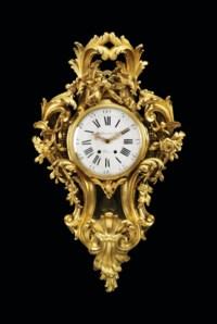 A LARGE FRENCH ORMOLU CARTEL CLOCK