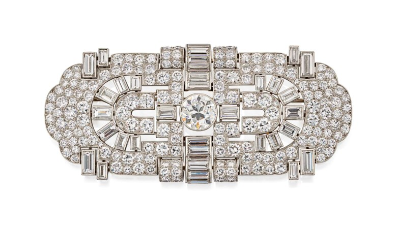 Art Déco Diamond Brooch, Köchert, circular and baguette-cut diamonds, converting into two clip brooches, gold (austrian marks), circa 1930.Length7.6 cm. Estimate £6,000-8,000. Offered in Important Jewels on 13 June 2018 at Christie's in London
