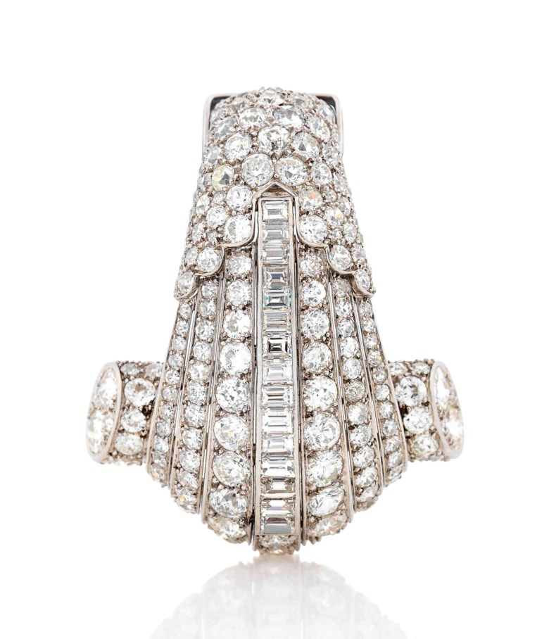 Art Deco diamond brooch, Cartier, circular and baguette-cut diamonds, platinum (French marks), circa 1930. Signed Cartier Paris, numbered. Sold for £27,500 on 13 June 2018 at Christie's in London