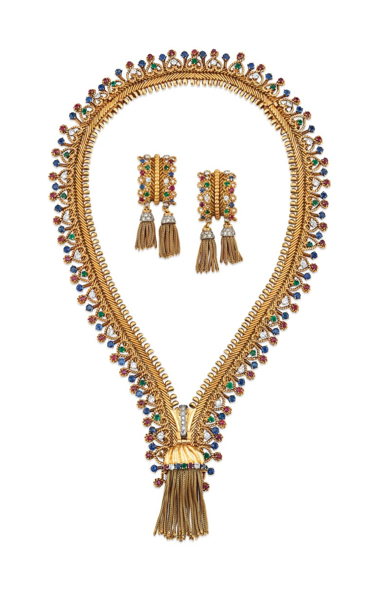 Iconic ruby, sapphire, emerald and diamond 'Zip' necklace and earrings set, Van Cleef & Arpels. Sold for £464,750 on 28 November 2018 at Christie's in London