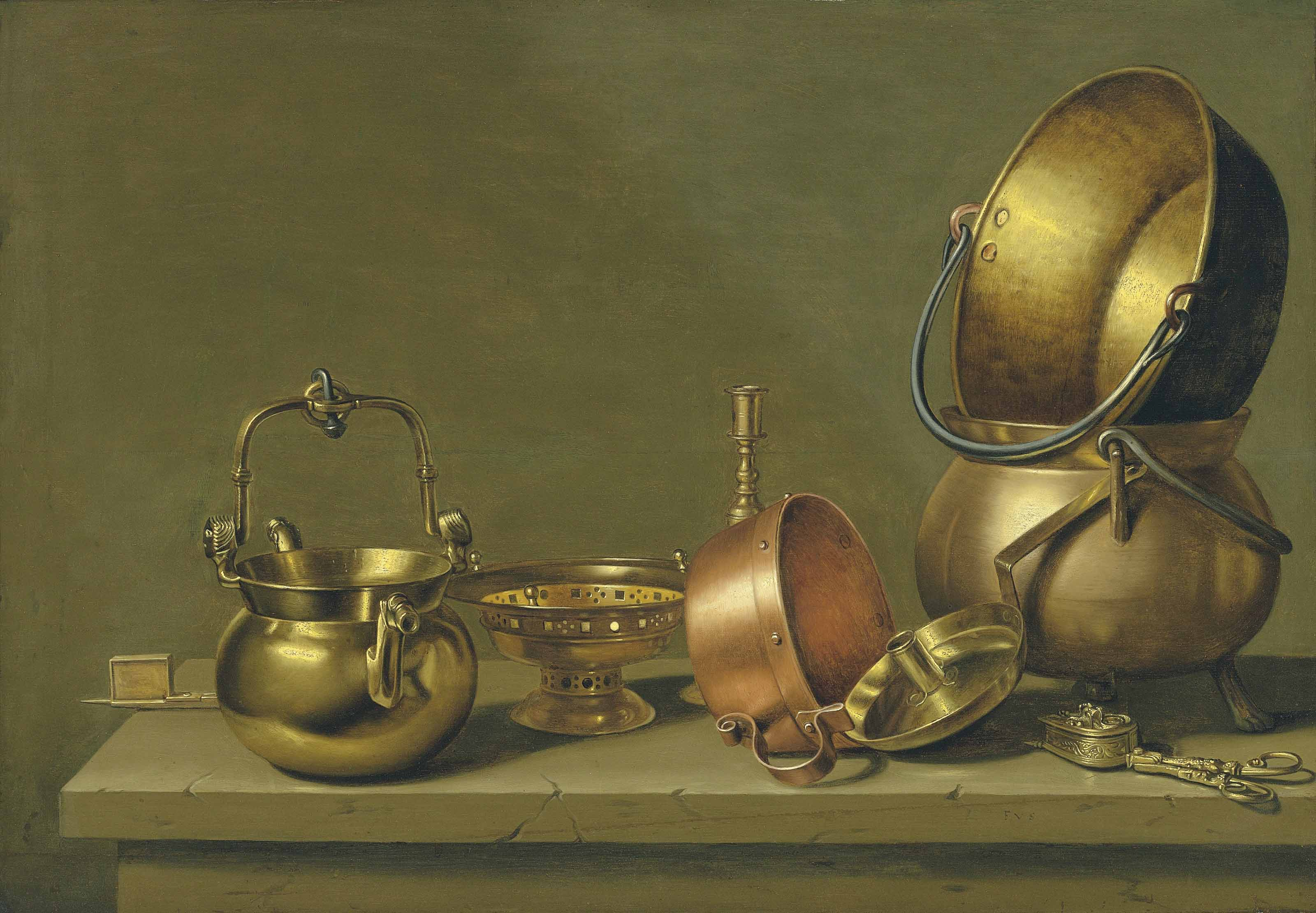 Copper and brass pans with other utensils on a ledge
