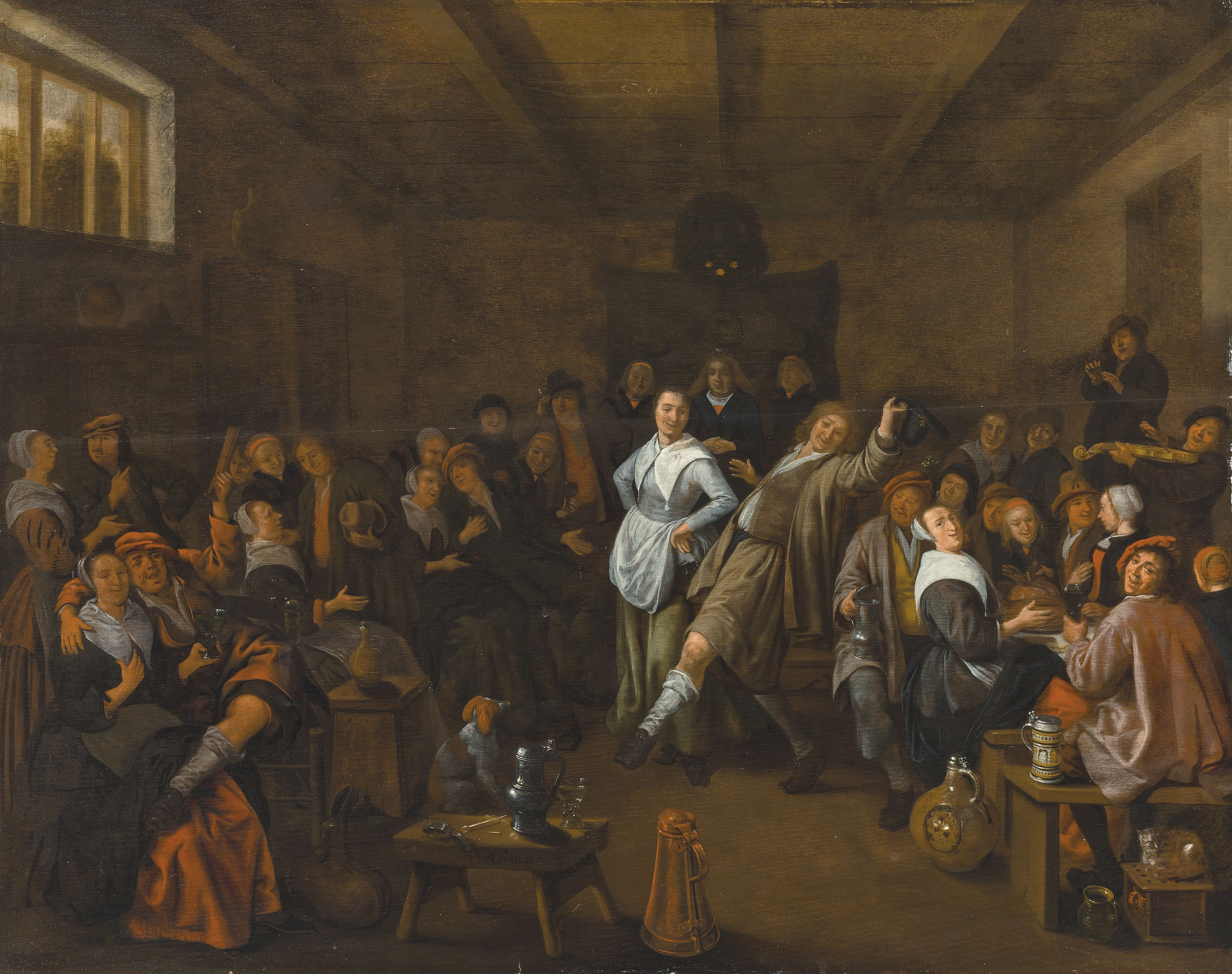 A tavern interior with figures merrymaking and carousing