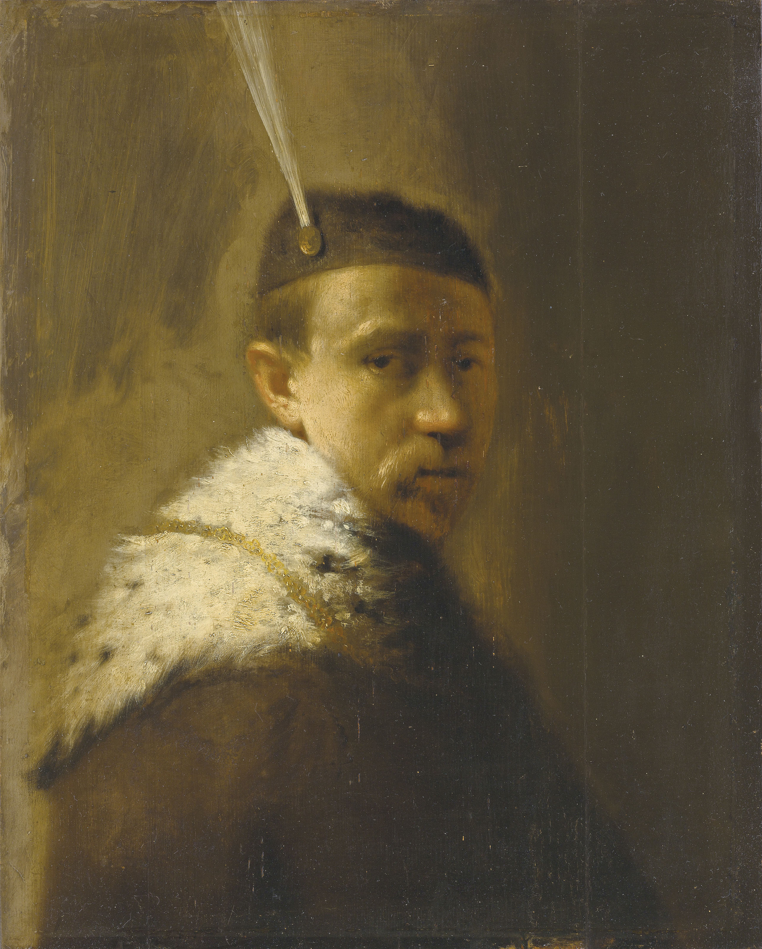 A man in a fur coat and a feathered hat