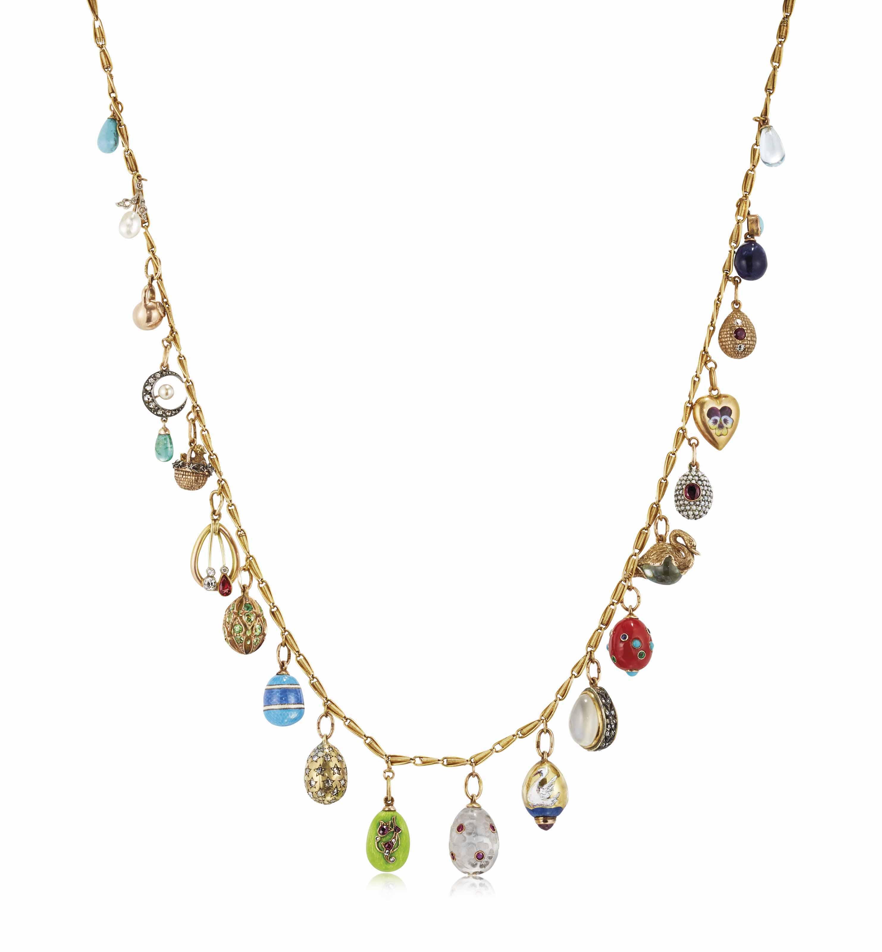 A NECKLACE OF TWENTY JEWELLED, GOLD, HARDSTONE AND GUILLOCHÉ ENAMEL EGG PENDANTS