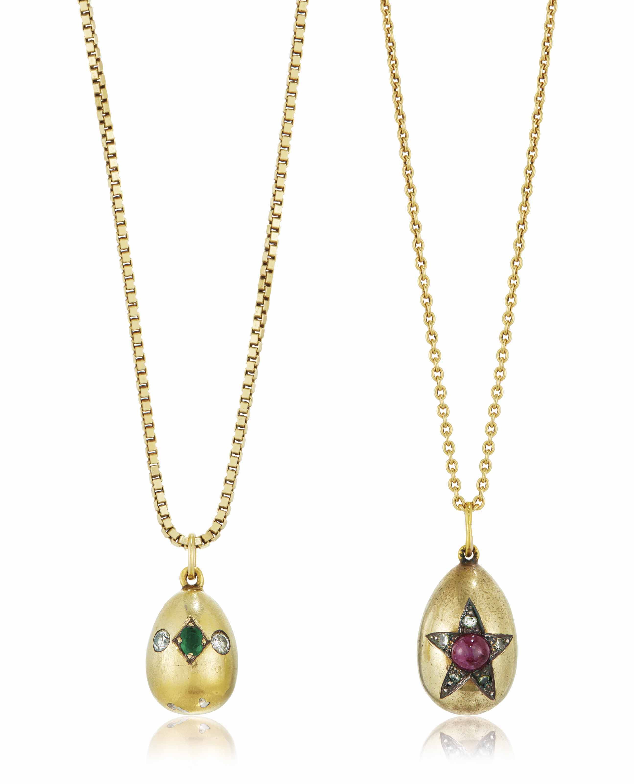 TWO JEWELLED GOLD AND SILVER-GILT EGG PENDANTS