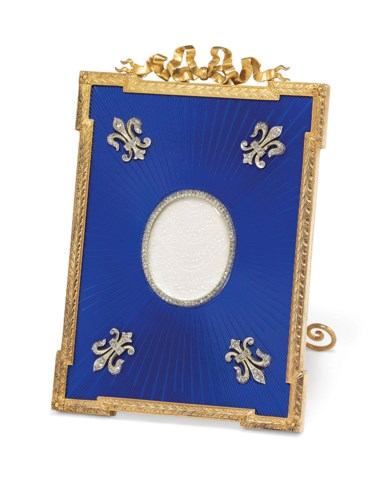 A jewelled silver-gilt mounted and guilloché enamel photograph frame, marked Fabergé, with the workmaster's mark of Michael Perchin, St Petersburg, 1899-1903, scratched inventory number 6918. 3⅞  in (10  cm) high. Sold for £27,500 on 4 June 2018 at Christie's in London