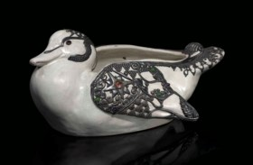 A RARE JEWELLED SILVER-MOUNTED EARTHENWARE DUCK-FORM BOWL