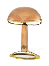 A RARE BRASS AND COPPER WAR TABLE LAMP