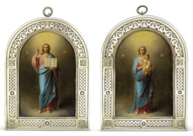 A PAIR OF SILVER-GILT ICONS DEPICTING THE MOTHER OF GOD AND CHRIST PANTOCRATOR