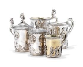 FIVE PARCEL-GILT SILVER CUPS