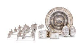 A GROUP OF TWELVE SILVER KNIFE RESTS, THREE BOXES, A NAPKIN RING AND A NIELLO TR