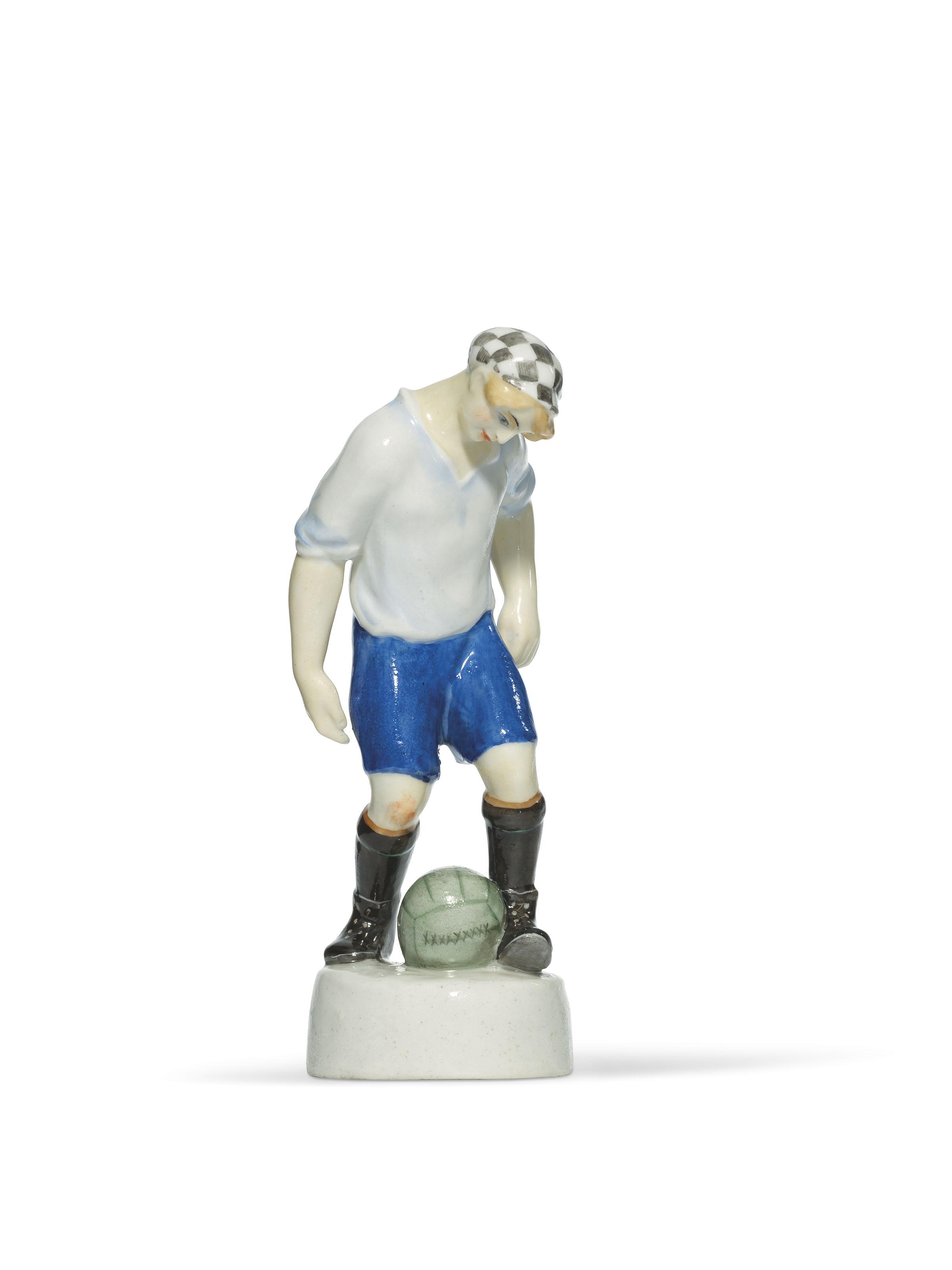 A SOVIET PROPAGANDA PORCELAIN FIGURE OF A FOOTBALLER