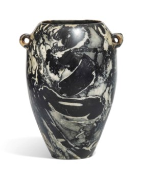 AN EGYPTIAN FOSSILIFEROUS LIMESTONE JAR