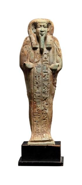 AN EGYPTIAN BLUE FAIENCE SHABTI FOR THE ROYAL SCRIBE HORKHEBI