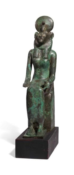 AN EGYPTIAN BRONZE WADJET-BAST