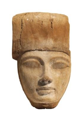 AN EGYPTIAN WOOD MUMMY MASK
